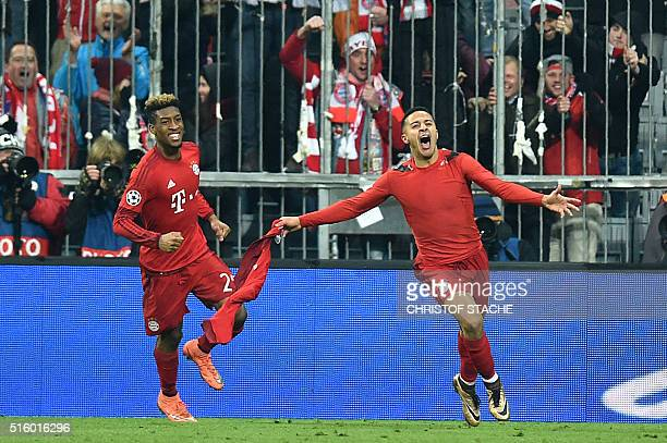 Bayern Munich's French defender Kingsley Coman and Bayern Munich's Spanish midfielder Thiago Alcantara celebrate victory at the end of the extra time...