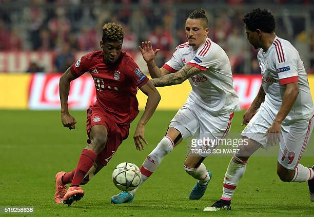 Bayern Munich's French defender Kingsley Coman and Benfica's Serbian midfielder Ljubomir Fejsa vie for the ball during the Champions League...