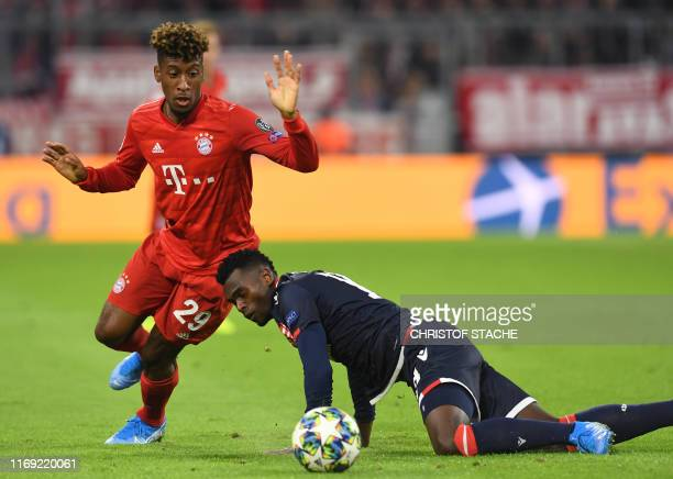 Bayern Munich's French defender Kingsley Coman and Red Star Belgrade's Brazilian defender Jander vie for the ball during the UEFA Champions League...