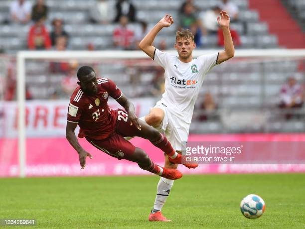 Bayern Munich's French defender Tanguy Nianzou and Moenchengladbach's German midfielder Mika Schroers vie for the ball during the Audi Summer Tour...