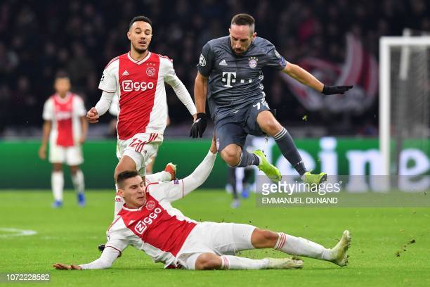 Bayern Munich's French forward Franck Ribery avoids a tackle by Ajax's Austrian defender Maximilian Wober during the UEFA Champions League Group E...