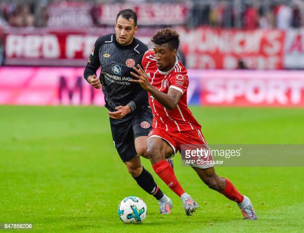Bayern Munich's French forward Kingsley Coman and Mainz' German midfielder Levin Oeztunali vie for the ball during the German first division...