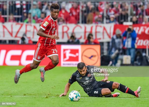 Bayern Munich's French forward Kingsley Coman and Mainz' Italian defender Giulio Donati vie for the ball during the German first division Bundesliga...