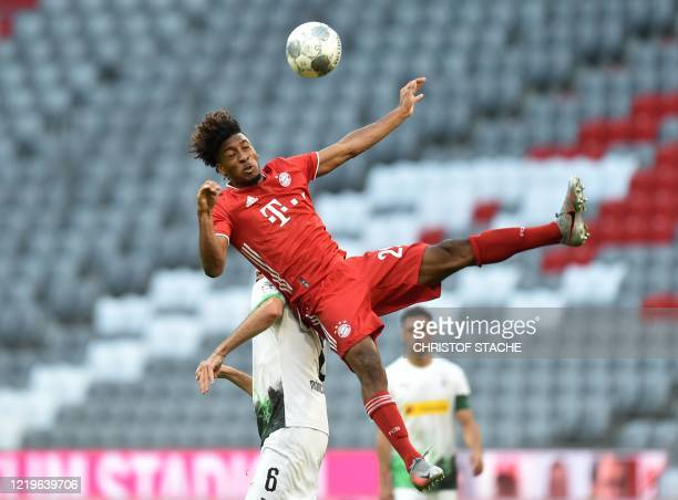 Bayern Munich's French forward Kingsley Coman and Moenchengladbach's German midfielder Christoph Kramer collide during the German first division...