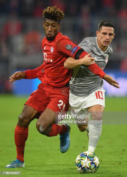 Bayern Munich's French forward Kingsley Coman and Olympiakos' Portuguese midfielder Daniel Podence vie for the ball during the UEFA Champions League...