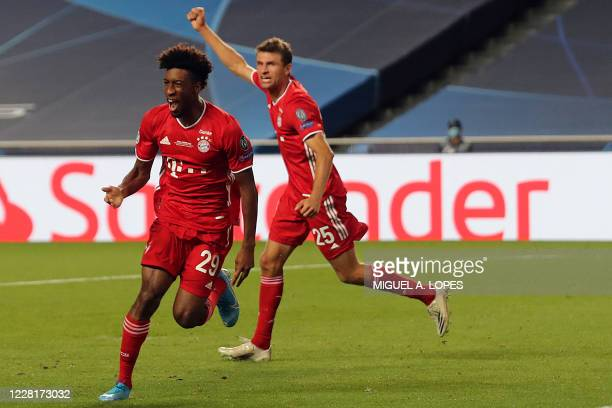 Bayern Munich's French forward Kingsley Coman celebrates scoring the opening goal with his teammates during the UEFA Champions League final football...