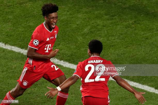 Bayern Munich's French forward Kingsley Coman celebrates with Bayern Munich's German midfielder Serge Gnabry after opening the scoring during the...