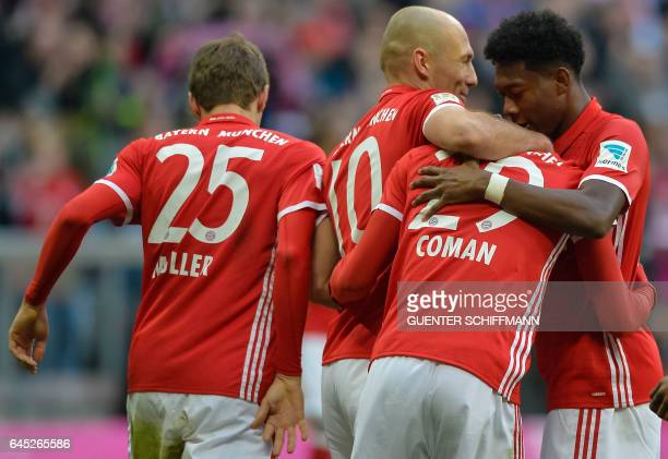 Bayern Munich's French forward Kingsley Coman celebrates with his teammates the seventh goal during the German first division Bundesliga football...