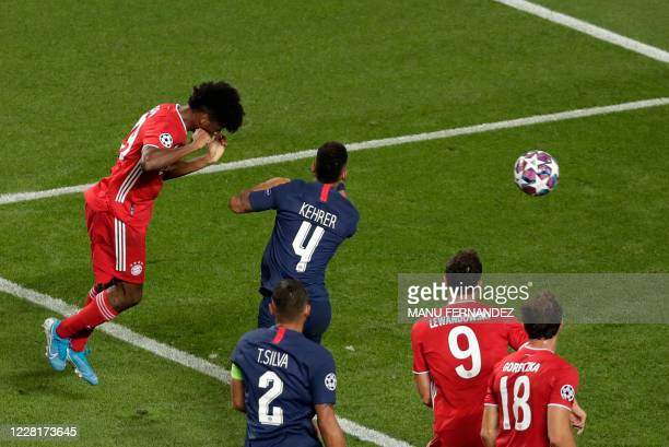 Bayern Munich's French forward Kingsley Coman heads the ball past Paris Saint-Germain's German defender Thilo Kehrer to open the scoring during the...