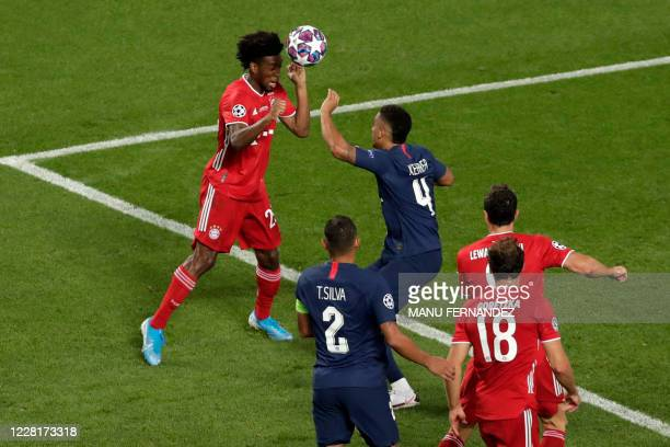 Bayern Munich's French forward Kingsley Coman heads the ball to open the scoring during the UEFA Champions League final football match between Paris...
