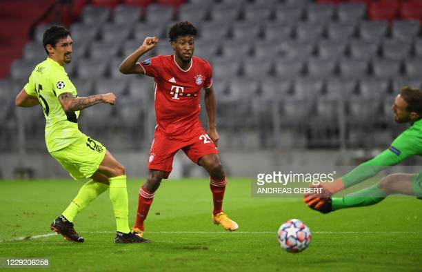 Bayern Munich's French forward Kingsley Coman scores the opening goal past Atletico Madrid's Slovenian goalkeeper Jan Oblak during the UEFA Champions...