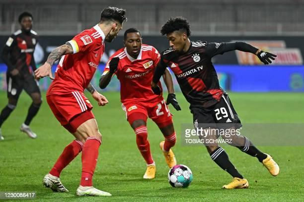 Bayern Munich's French forward Kingsley Coman , Union Berlin's Dutch forward Sheraldo Becker and Union Berlin's Austrian defender Christopher Trimmel...