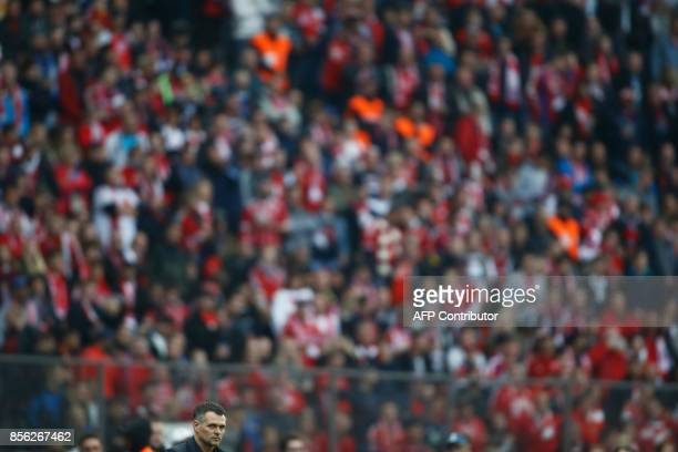 Bayern Munich's French interim head coach Willy Sagnol follows the action during the German first division Bundesliga football match between Hertha...