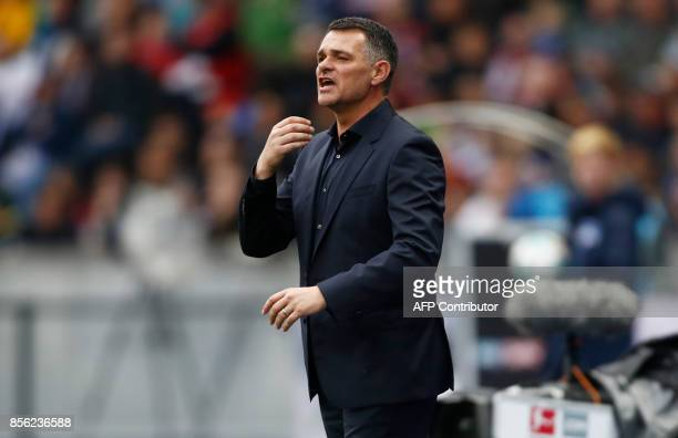 Bayern Munich's French interim head coach Willy Sagnol gestures from the sidelines during the German first division Bundesliga football match between...