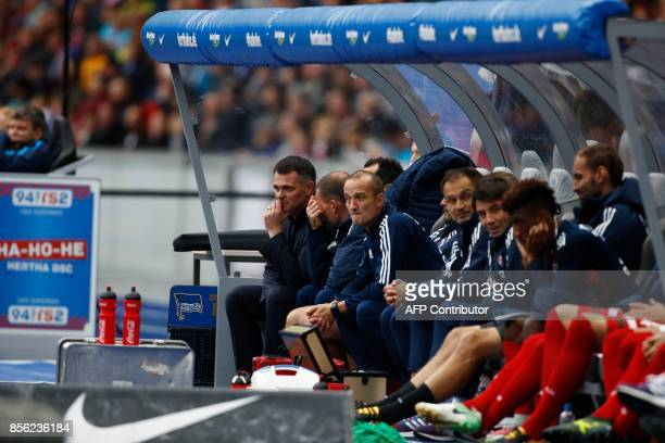 Bayern Munich's French interim head coach Willy Sagnol sits on the bench during the German first division Bundesliga football match between Hertha...