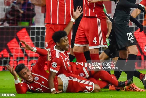 Bayern Munich's French midfielder Corentin Tolisso and Bayern Munich's Austrian midfielder David Alaba lie on the pitchduring the UEFA Champions...