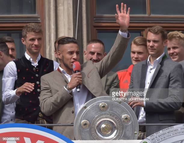 Bayern Munich's French midfielder Corentin Tolisso and his teammates celebrate on the balcony of the city hall in Munich southern Germany on May 20...