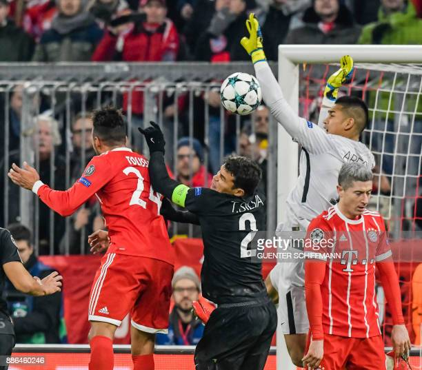 Bayern Munich's French midfielder Corentin Tolisso and Paris SaintGermain's Brazilian defender Thiago Silva and vie for the ball as Bayern Munich's...