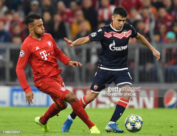 Bayern Munich's French midfielder Corentin Tolisso and Red Star Belgrade's Argentinian midfielder Mateo Garcia vie for the ball during the UEFA...