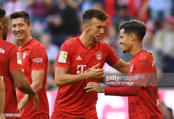 Bayern Munich's French midfielder Corentin Tolisso Bayern Munich's Polish forward Robert Lewandowski Bayern Munich's Croatian midfielder Ivan Perisic...