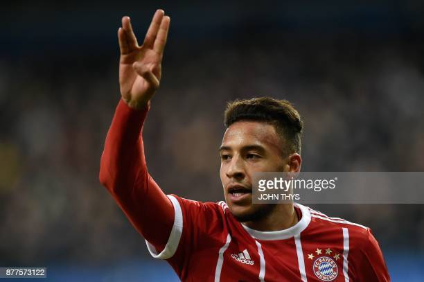 Bayern Munich's French midfielder Corentin Tolisso celebrates after scoring a goal during the UEFA Champions League Group B football match between...