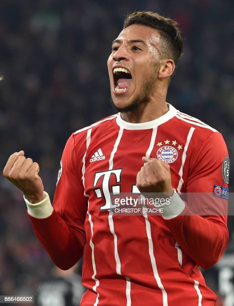 Bayern Munich's French midfielder Corentin Tolisso celebrates after scoring the second goal for Munich during the UEFA Champions League football...