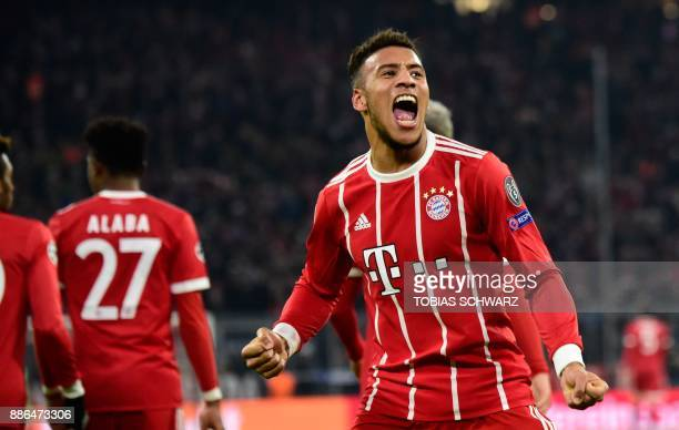 Bayern Munich's French midfielder Corentin Tolisso celebrates after scoring the 31 during the UEFA Champions League football match of Bayern Munich...