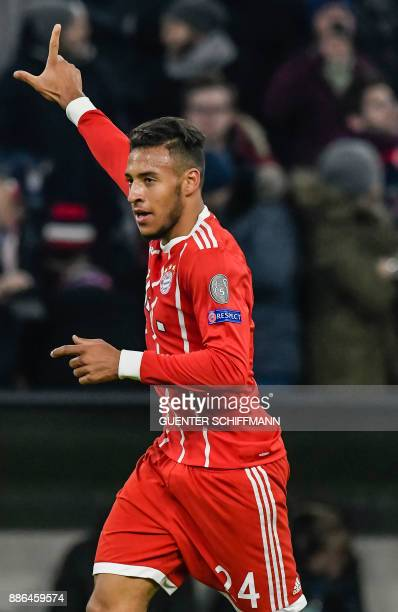 Bayern Munich's French midfielder Corentin Tolisso celebrates his goal during the UEFA Champions League football match between Paris SaintGermain and...