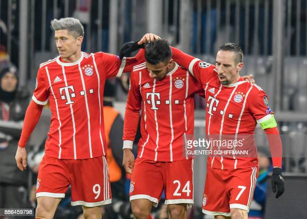 Bayern Munich's French midfielder Corentin Tolisso celebrates his goal with Bayern Munich's Polish forward Robert Lewandowski and Bayern Munich's...