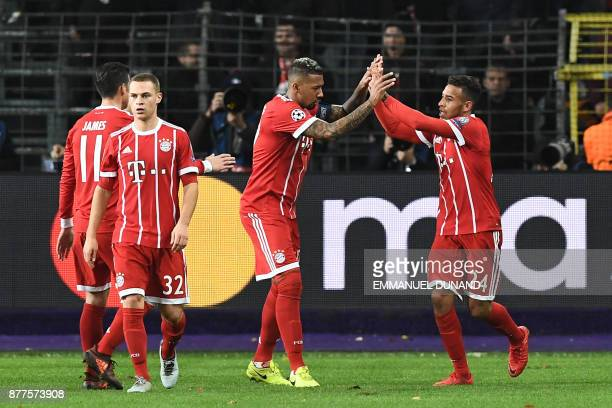 Bayern Munich's French midfielder Corentin Tolisso celebrates with teammates after scoring a goal during the UEFA Champions League Group B football...