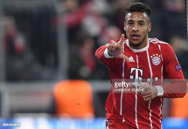 Bayern Munich's French midfielder Corentin Tolisso gestures after scoring the 31 during the UEFA Champions League football match of Bayern Munich vs...