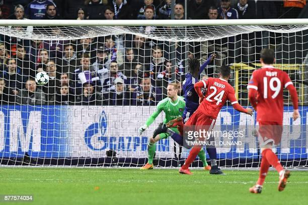 Bayern Munich's French midfielder Corentin Tolisso scores a goal past Anderlecht's Belgian goalkeeper Matz Sels during the UEFA Champions League...