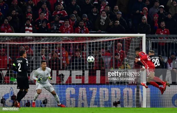 Bayern Munich's French midfielder Corentin Tolisso scores the 20 during the UEFA Champions League football match of Bayern Munich vs Paris...