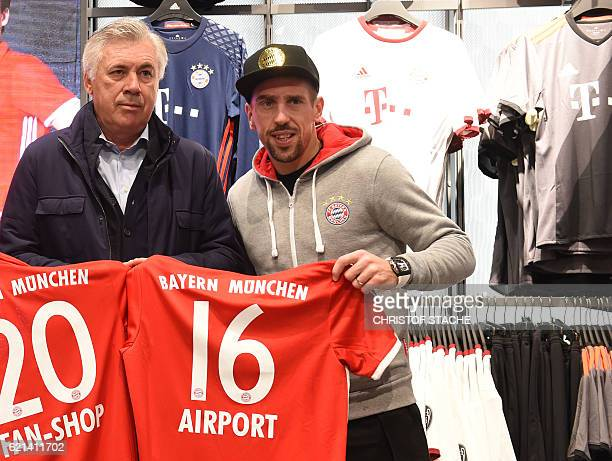 Bayern Munich's French midfielder Franck Ribery and Bayern Munich's Italian headcoach Carlo Ancelotti pose during the official reopening of the new...