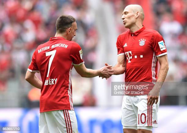 Bayern Munich's French midfielder Franck Ribery and Bayern Munich's Dutch midfielder Arjen Robben shake hands after the German first division...