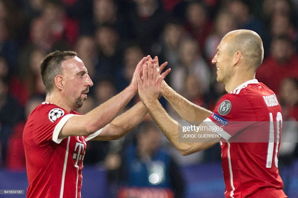 Bayern Munich's French midfielder Franck Ribery (L) and Bayern Munich's Dutch midfielder Arjen Robben celebrate their team's second goal during the UEFA Champions League quarter-final first leg football match between Sevilla FC and Bayern Munich at the Ramon Sanchez Pizjuan Stadium in Sevilla on April 3, 2018. /