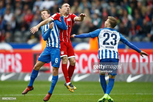 Bayern Munich's French midfielder Franck Ribery and Berlin's Czech midfielder Vladimir Darida vie for the ball during the German first division...