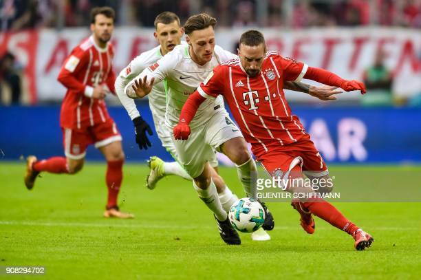 Bayern Munich's French midfielder Franck Ribery and Bremen's German defender Robert Bauer vie for the ball during the German first division...