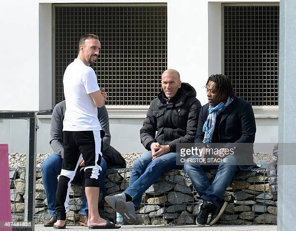 Bayern Munich's French midfielder Franck Ribery and former French soccer players Zinedine Zidane and Bernard Diomede talk during a training session...