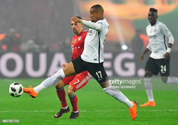 Bayern Munich's French midfielder Franck Ribery and Frankfurt's Ghanaian midfielder KevinPrince Boateng vie for the ball during the German Cup DFB...