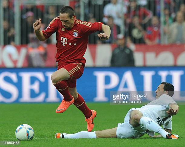 Bayern Munich's French midfielder Franck Ribery and Hanover's midfielder Sergio Pinto challenge for the ball during the German first football...