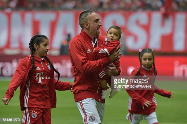 Bayern Munich's French midfielder Franck Ribery and his children are seen on tge pitch prior to the German first division Bundesliga football match...