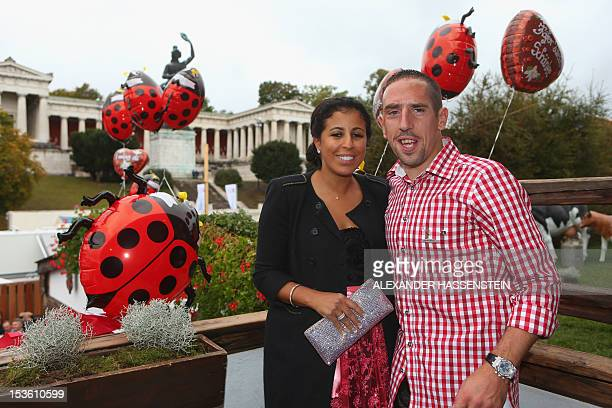 Bayern Munich's French midfielder Franck Ribery and his wife Wahiba Belhami pose for photographers during the traditional visit by German Bundesliga...