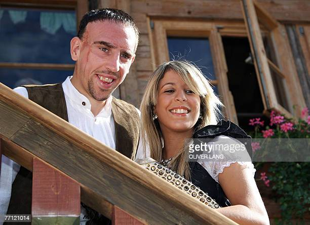 Bayern Munich's French midfielder Franck Ribery and his wife Wahiba Belhami pose for a photo wearing traditional Bavarian clothes as the visit the...