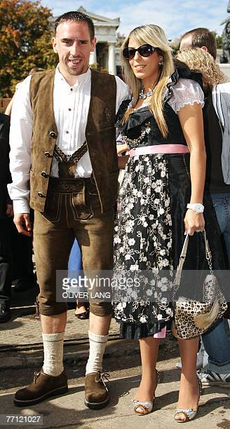 Bayern Munich's French midfielder Franck Ribery and his wife Wahiba Belhami pose for a photo wearing tradional Bavarian clothes as the visit the...