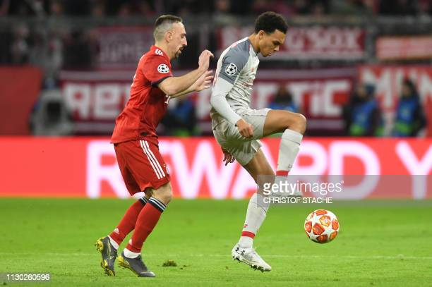 Bayern Munich's French midfielder Franck Ribery and Liverpool's English defender Trent AlexanderArnold vie for the ball during the UEFA Champions...