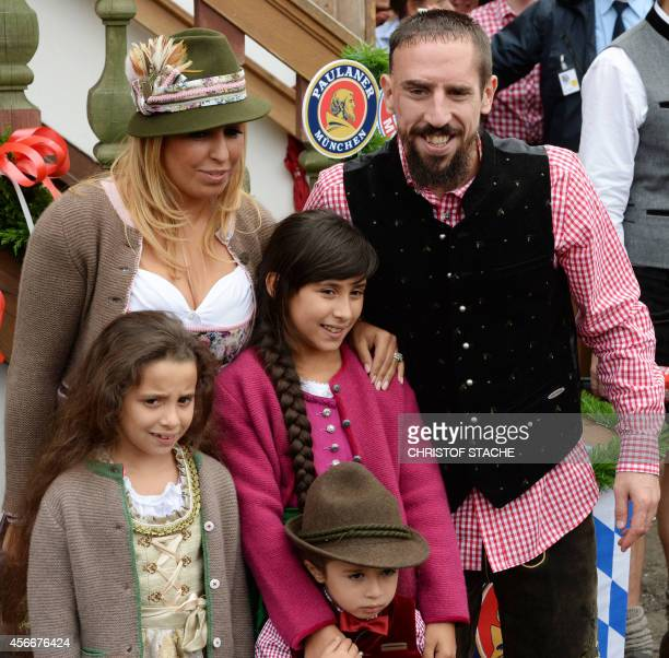 Bayern Munich's French midfielder Franck Ribery arrives with his wife Wahiba Ribery Belhami and their children for the traditional visit of FC Bayern...