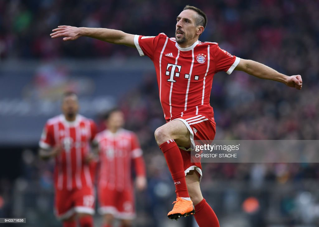 Bayern Munich's French midfielder Franck Ribery celebrates after scoring the 5-0 goal for Munich during the German first division Bundesliga football match FC Bayern Munich vs Borussia Dortmund in Munich, southern Germany, on March 31, 2018. / AFP PHOTO / Christof