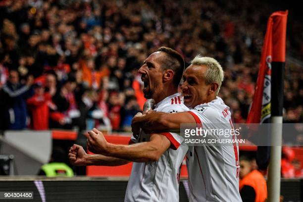 Bayern Munich's French midfielder Franck Ribery celebrates scoring with his teammate Rafinha during the German First division Bundesliga football...