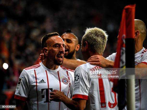 Bayern Munich's French midfielder Franck Ribery celebrates scoring with his teammates during the German First division Bundesliga football match...